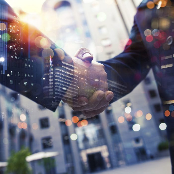 handshaking-business-person-in-office-concept-of-teamwork-and-partnership-194854032