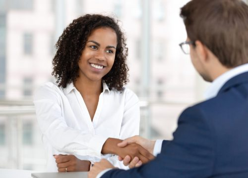 smiling-african-hr-manager-handshake-hire-candidate-at-job-interview-146301217